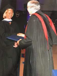 Anastasia receiving her degree